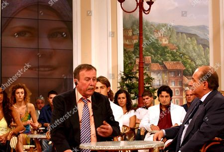 Natascha Kampusch's Father Luwing Koch (l) Listens to Italian Anchorman Giancarlo Magalli Monday 11 September 2006 During the 'Piazza Grande' (great Place) Talk-show He Went Over the Whole Story of the Disappearance of Her Daughter Natascha Since She was Kidnapped at the Age of 10 As She Walked to School Speaking About the Moment the Family was Reunited Kampusch's Father Ludwig Koch Told the Austrian Daily Kurier: 'She Said: 'Dad i Love You ' and the Next Question Was: 'Is My Toy Car Still There?' It was Natascha's Favourite Toy i Never Gave It Away in All Those Years ' Italy Rome