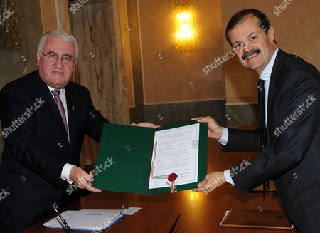 General Secretary of Farnesina (italian Foreign Ministry) Giampiero Massolo (r) Poses For a Photo with Irish European Affairs Minister Dick Roche During the Deposition of the Ratification of the Treaty of Lisbon on 23 October 2009 at Farnesina Palace in Rome Italy Italy Rome