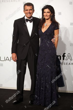 President of 'Salvatore Ferragamo' Ferruccio Ferragamo (l) Arrives with His Wife Ilaria at the Amfar Charity Party During the Milan Fashion Week Spring / Summer 2010 in Milan Italy 28 September 2009 Italy Milan