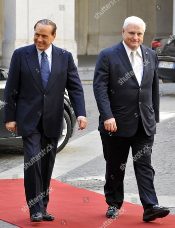 Italian Prime Minister Silvio Berlusconi (l) and Panama's President Ricardo Alberto Martinelli Berrocal Walk in the Yard of Chigi Palace Rome Italy During Their Meeting on 11 September 2009 Italy Rome