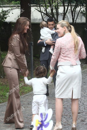 Stock Photo of Eleonora Berlusconi (l) Alessandro (barbara's Son C) and Barbara Berlusconi (r) Walk Towards Giorgio Valaguzza (barbara's Husband) with Second Son Edoardo at the Wedding of Marinella Brambilla Secretary of Prime Minister Silvio Berlusconi and Luca Pandolfi at Lesmo (near Monza) Italy 24 April 2010 Veronica Lario Berlusconi's Wife and Her Daughters Barbara and Eleonora Berlusconi Were Among the Guests Italy Monza