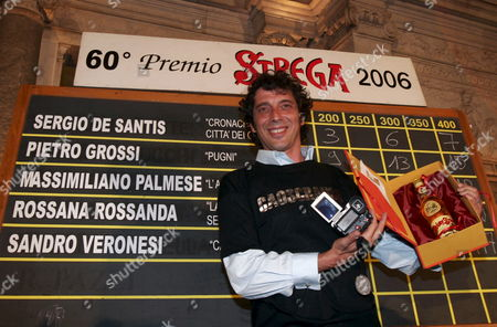 Italian Writer Sandro Veronesi Holds the Trophy After Winning with His Book 'Caos Calmo' the 60th Edition of the Premio Strega the Most Important Italian Literature Award in Rome's Ninfeo Di Villa Giulia Late Thursday 06 July 2006 Italy Rome