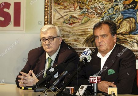 Former Reforms Minister and Now Deputy Upper House of Italian Parliament Speaker Roberto Calderoli (r) Addresses Journalists Together with Member of European Parliament Mario Borghezio 26 June 2006 in Milan During the Press Conference After the Result of the Referendum Vote in Italy Italy Milan