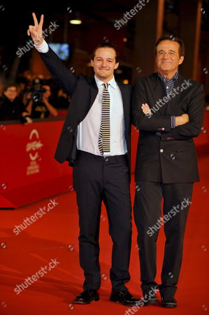 Film Director Brando De Sica and His Father Actor and Director Cristian Pose For a Photograph on the Red Carpet to Present Brando 'S De Sica Film 'Parlami Di Me (tell Me About Me)' at the 3rd Rome Film Festival Italy 24 October 2008 Italy Roma