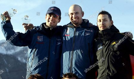 Leader of the World Cup Us Zach Lund (c) who Won the Race Compatriot Eric Bernotas (l) who Placed Second and German Michi Halilovic who Placed Third Celebrate on the Podium of the 2006/07 Fibt Men's Skeleton Tour in Cesana Pariol Near Turin on Friday 09 February 2007 Italy Cesana Pariol