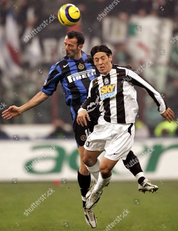 Stock Photo of Giuseppe Pancaro (l) of Fc Inter and Mauro German Camoranesi of Juventus Fc Duel For the Ball in Mid-air During Their Italian Serie a Soccer Match in Milan's San Siro-giuseppe Meazza Stadium Late Sunday 28 November 2004 Italy Milan