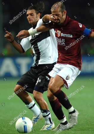 Midfielder Andrea Pisanu (l) of Parma Ac and Defender Giuseppe Pancaro of Torino Fc Struggle For the Ball During Their Italian Serie a Soccer Match in Turin's New Olympic Stadium Late Sunday 10 September 2006 the Match Ended with a 1-1 Draw Italy Turin