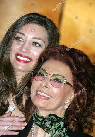 Italian Actresses/cast Members Sophia Loren (r) and Margret Made Pose During a Photocall For the Television Mini-series 'La Mia Casa E Piena Di Specchi' (my House is Full of Mirrors) in Rome Italy 10 March 2010 Loren Plays Her Own Mother Romilda Villani in the Tv Mini-series by Italian Director Vittorio Sindoni and Made Plays Loren Based on the Book by Loren's Sister Maria Scicolone the Italian Television Channel Rai Uno Mini-series Will Be Broadcasted on 14 and 15 March Italy Rome