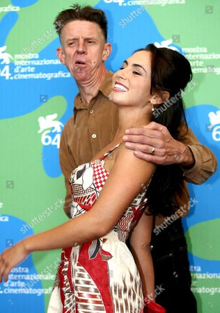 The English Director Alex Cox (l) Poses with the Actress Jaclyn Jonet at the End of Press Conference of Presentation of 'Searches 2 0' a Alex Cox's Movie in Concourse For the Venice Film Festival in Venice Italy 31 August 2007 Italy Venice