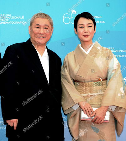 Japanese Actor and Director Takeshi Kitano (l) and Japanese Actress Kanako Higuchi Pose For Photographers During a Photocall For His Film 'Akires to Kame' ('achilles and the Tortoise') Running in Competition at the 65th International Film Festival of Venice 28 August 2008 in Venice Italy the Festival is Scheduled For 27 August to 06 September 2008 Italy Venice