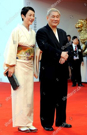 Japanese Actor and Film Director Takeshi Kitano (r) with Japanese Actress Kanako Higuchi Pose For a Photo on the Red Carpet Prior the Screening of the Film 'Achilles and the Tortoise' For the 65th Venice International Film Festival Organised by the Venice Biennale 28 August 2008 in Venice Italy Italy Venice