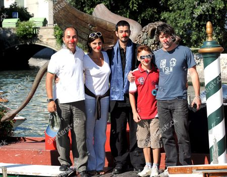 (l-r) Italian Filmmaker Marco Pontecorvo with Actors Evita Ciri Miloud Oukili Robert Valeanu and Jalil Lespert on 27 August 2008 Pose For a Photo at the Arrival in Venice Lido Italy Pontecorvo's Movie 'Pa-ra-dal' Will Be Presented 28 August 2008 Italy Venice