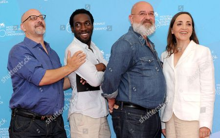 (l-r) Director Pierre Trividic Actor Cyril Guei Director Patrick-mario Bernard and Actress Dominique Blanc Pose For Photographers After the Press Conference For Their Film 'L'autre' Running in Competition at the 65th International Film Festival of Venice 31 August 2008 in Venice Italy the Festival is Scheduled For 27 August to 06 September 2008 Italy Venice