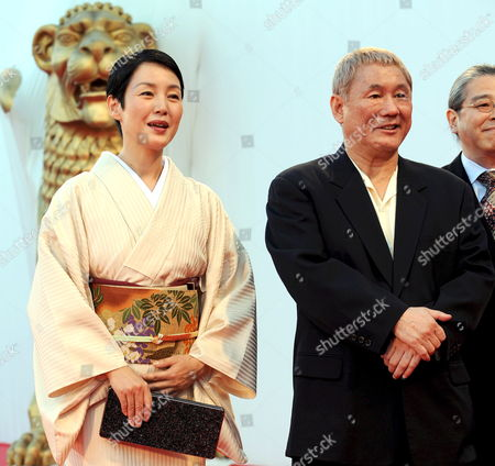 Stock Picture of Japanese Actor and Film Director Takeshi Kitano (r) with Japanese Actress Kanako Higuchi Pose For a Photo on the Red Carpet Prior the Screening of the Film 'Achilles and the Tortoise' For the 65th Venice International Film Festival Organised by the Venice Biennale 28 August 2008 in Venice Italy Italy Venice