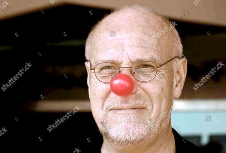 Stock Photo of Director of Venice Biennale Marco Muller Poses For a Photo with a Red Clown Nose After the Press Conference of the Film: 'Pa-ra-dal' Directed by Italian Filmmaker Marco Pontecorvo Presented at 65th Venice International Film Festival in Venice Italy 28 August 2008 Italy Venice