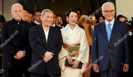 Stock Image of Japanese Actor and Film Director Takeshi Kitano (2-l) with Japanese Actress Kanako Higuchi Director Marco Mueller (l) with President of Rom's Accademia Filarmonica Paolo Baratta (r) Pose For a Photo on the Red Carpet Prior the Screening of the Film 'Achilles and the Tortoise' For the 65th Venice International Film Festival Organised by the Venice Biennale 28 August 2008 in Venice Italy Italy Venice