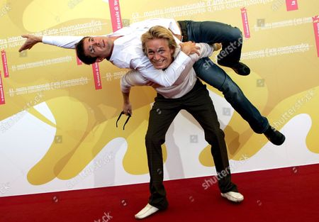 Stock Image of Actors Jeremie and Yannick Renier Pose For Photographers at the End of a Press Conference to Promote the Movie 'Nue Propriete' (private Property) Presented in the Competition at the 63rd Edition of the Venice Film Festival Italy Thursday 07 September 2006 Italy Venice