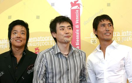 Korean Producer Ryoo Seung-wan Poses For a Photo on Friday 01 September 2006 in Venice with the Actors Beom-soo (l) and Jung Doo-hong During the Press Conference to Promote the Film 'Jak-pae' (the City of Violence) at the 63rd Edition of the Venice Film Festival Italy Venice