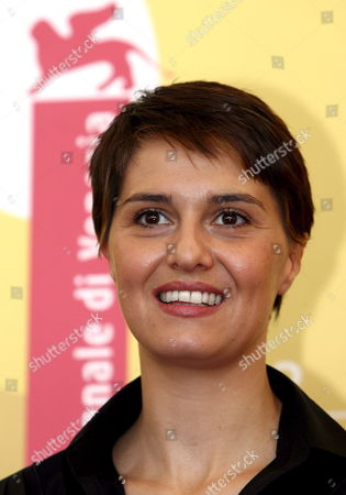 Italian Actress Paola Cortellesi Poses For a Photo at the End of the Press Conference to Promote the Movie ''don't Take Any Date For Tonight' by Director Gianluca Maria Tavarelli at the Venice Film Festival Monday 04 September 2006 Italy Venice