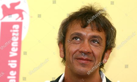 Italian Director Gianluca Maria Tavarelli Poses For a Photo at the End of the Press Conference to Promote His Movie ''don't Take Any Date For Tonight' at the Venice Film Festival Monday 04 September 2006 Italy Venice