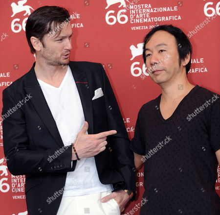 Stock Picture of Actor/cast Member Eric Bossick (l) and Movie Director Shinya Tsukamoto Pose For Photographers During the Photocall For 'Tetsuo: the Bullet Man' During the 66th Venice Film Festival in Venice Italy 05 September 2009 the Film is Presented in Competition at the Festival Running Until 12 September Italy Venice