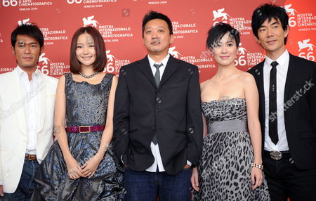 Chinese Movie Director Soi Cheang (c) and Actors/cast Members (l-r) Louis Koo Han Yuqin Michelle Ye and Richie Jen Pose For Photographers During the Photocall For Their Film 'Yi Ngoy (accident)' During the 66th Venice Film Festival in Venice Italy 05 September 2009 'Yi Ngoy (accident)' is Presented in Competition at the Festival Running Until 12 September Italy Venice