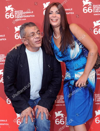 Egyptian Movie Director Yousry Nasrallah (l) Poses with Actress Mona Zakki During the Photocall For 'Schahrazad Tell Me a Story' out of Competition at the 66th Venice Film Festival in Venice Italy 03 September 2009 the Festival Will Run Until 12 September Italy Venice