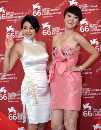 Stock Picture of Cast Members and Actresses Wu Anya (l) and Tan Weiwei Pose During the Photocall For the Film 'Chengdu Wo Ai Ni' (chengdu i Love You) During the 66th Venice Film Festival in Venice Italy 12 September 2009 the Movie by Fruit Chan and Cui Jian is Presented out of the Competition During the Closing Ceremony of the Festival Italy Venice
