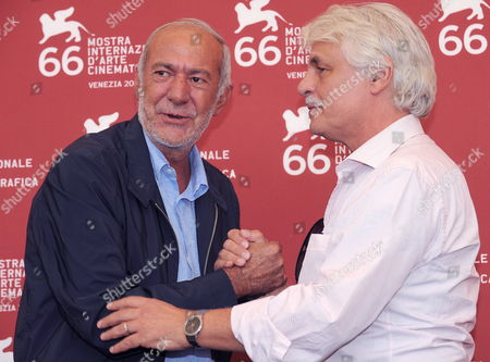 Stock Image of Italian Writer and Politician Mario Capanna (l) and Director Michele Placido (r) Attend a Photocall For the Film 'Il Grande Sogno' During the 66th Venice Film Festival in Venice Italy 09 September 2009 Presented in the Official Competition the Film 'Il Grande Sogno' is Set in Italy in 1968 when Young People Were Dreaming They Could Change the World Capanna was the Leader of the Italian Students' Movement in the Late 1960s and Early 1970s Italy Venice
