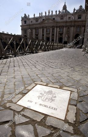 The Marble Slab on the Exact Spot in St Peter's Square where Pope John Paul Ii was Shot in an Assassination Attempt 25 Years Ago Friday 12 May 2006 the Slab Which is Engraved with the Late Pope's Coat of Arms Replaced a Red-painted Cobblestone Which Had Indicated the Location where Pope Wojtyla was Hit by Bullets Fired by Turkish Terrorist Ali Agca on 13 May 1981 the Pope was Greeting and Blessing a Cheering Crowd From His 'Popemobile' After a General Audience when He was Shot the 25th Anniversary of the Assassination Attempt Will Be Celebrated Here on Saturday with a Number of Events Expected to Draw Some 20 000 People Our Lady of Fatima Statue From Portugal the Statue Will Be Lifted by Helicopter From the Banks of the Tiber River in Front of Castel Sant'angelo and Brought to the Head of Via Della Conciliazione Vatican City State (holy See) Vatican City