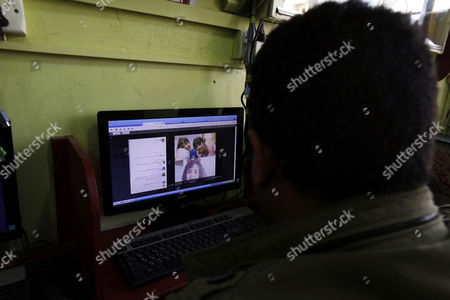 Stock Picture of A Yemeni man looks at the picture of an alleged victim, 8-year-old Yemeni girl Anwar al-Awlaki, of the recent US raid in central Yemen, at a cafe in Sana'a, Yemen, 30 January 2017. According to reports, elite US forces launched on 29 January a dawn raid against suspected al-Qaeda militants in central Yemen, killing 41 militants and 16 civilians-eight women and eight children, including the eight-year-old daughter, Anwar al-Awlaki of US-born Yemeni preacher Anwar al-Awlaki who was killed by an American drone strike in 2011.