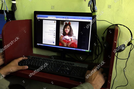 A Yemeni man looks at the picture of an alleged victim, 8-year-old Yemeni girl Anwar al-Awlaki, of the recent US raid in central Yemen, at a cafe in Sana'a, Yemen, 30 January 2017. According to reports, elite US forces launched on 29 January a dawn raid against suspected al-Qaeda militants in central Yemen, killing 41 militants and 16 civilians-eight women and eight children, including the eight-year-old daughter, Anwar al-Awlaki of US-born Yemeni preacher Anwar al-Awlaki who was killed by an American drone strike in 2011.