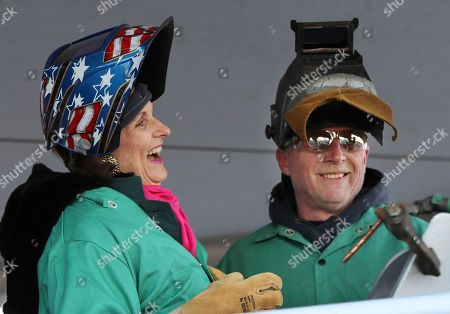 Lynda Johnson Robb, Timothy Trask Lynda Johnson Robb, a daughter of the late President Lyndon B. Johnson, laughs after lifting her welding mask after assisting Bath Iron Works welder Timothy Trask at a keel-laying ceremony for the future USS Lyndon B. Johnson, at Bath Iron Works in Bath, Maine. The ceremony marked the joining of two massive hull units, the first of several that will comprise the 610-foot Zumwalt class destroyer