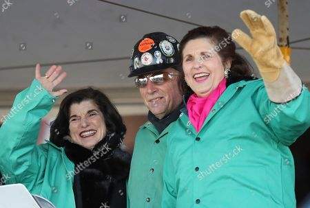Stock Image of Luci Baines Johnson, Lynda Johnson Robb, Timothy Trask Luci Baines Johnson, left, and Lynda Johnson Robb, daughters of the late President Lyndon B. Johnson, acknowledge the crowd after assisting Bath Iron Works welder Timothy Trask, center, at a keel-laying ceremony for the future USS Lyndon B. Johnson, at BIW in Bath, Maine. The ceremony marked the joining of two massive hull units, the first of several that will comprise the 610-foot Zumwalt class destroyer
