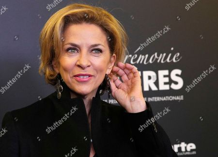 French actress Corinne Touzet poses during a photocall prior to the 22st Lumieres awards ceremony in Paris, France