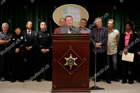 Los Angeles County Sheriff Jim McDonnell, center, speaks during a news conference, in Los Angeles. McDonnell said the man who raped and killed the ex-wife of Righteous Brothers singer Bill Medley in 1976 was shot and killed by police more than three decades ago