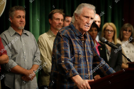 Righteous Brothers singer Bill Medley talks to reporters during a news conference, in Los Angeles. Officials say the man who raped and killed the ex-wife of Medley in 1976 was shot and killed by police more than three decades ago