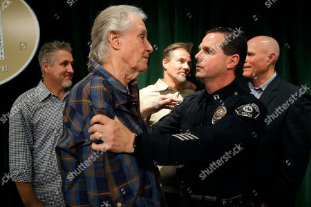 Bill Medley, Milton McKinnon Righteous Brothers singer Bill Medley, front left, is comforted by Hermosa Beach police captain Milton McKinnon after a news conference, in Los Angeles. Officials say the man who raped and killed the ex-wife of Medley in 1976 was shot and killed by police more than three decades ago
