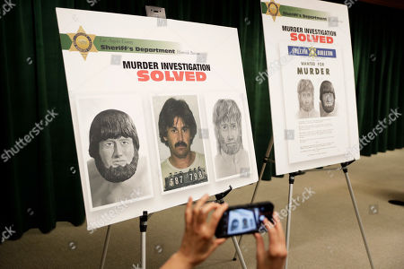 A reporters take photos of posters showing images of a suspect in the 1976 murder of Karen Klaas, ex-wife of the Righteous Brothers singer Bill Medley, at a news conference, in Los Angeles. Officials say the man who raped and killed Klaas was shot and killed by police more than three decades ago