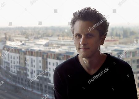 Stock Image of Box CEO and co-founder Aaron Levie poses for a photo while being interviewed at his office in Redwood City, Calif., . The heads of Apple, Ford and Goldman Sachs said that they don't support the executive order that President Donald Trump signed last week, which bans immigrants from seven Muslim-majority countries from entering the U.S. Google said it is donating cash to organizations that support immigrants. Other companies said they will help employees affected by the ban or, in the case of Starbucks, hire refugees