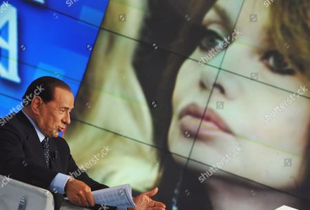 Italian Prime Minister Silvio Berlusconi Sit with a Background Picture of His Wife Veronica Lario During the Raiuno Television Programme 'Porta a Porta' (door to Door) at Rai Studios on 05 May 2009 Berlusconi Said During the Show That the Suggestion by His Wife and the Italian Media That He Had a Relationship with an 18-year-old Girl was a 'Lie' and Demands His Wife Admit She was Wrong if Their Relationship is to Survive Italy Rome