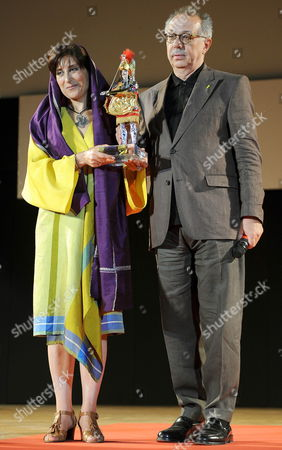 Iranian Actress Fatemeh Motamed-arya (l) Receives the Taormina Arte Award on Behalf of Iranian Director Jafar Panahi (unseen) From Director of the Berlin International Film Festival and Jury Member Dieter Kosslick (r) at the 2010 Taormina Film Festival in Taormina Sicily Island Italy 15 June 2010 the 56th Edition of the Festival Runs From 12 Until 18 June Italy Taormina