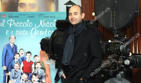 Stock Image of French Director Laurent Tirard Poses For Photographs After a Press Conference to Promote His Movie 'Le Petit Nicolas' (english Title: Little Nicholas) in Rome Italy 22 March 2010 Italy Rome