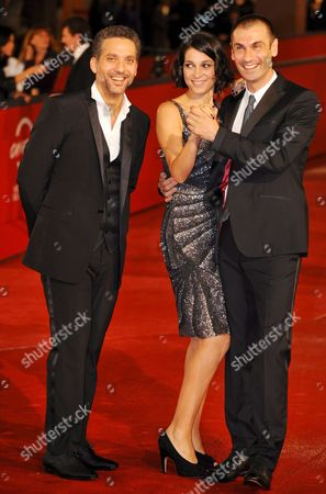 Italian Actors (l-r) Beppe Fiorello Donatella Finocchiaro and Fabrizio Gifuni Pose on the Red Carpet As They Arrive at Rome's Park of the Music Auditorium For the Screening of the Film 'Galantuomini' by Compatriot Edoardo Winspeare Late 27 October 2008 Presented in Competition at the 3rd Rome International Film Festival in Rome Italy Italy Rome