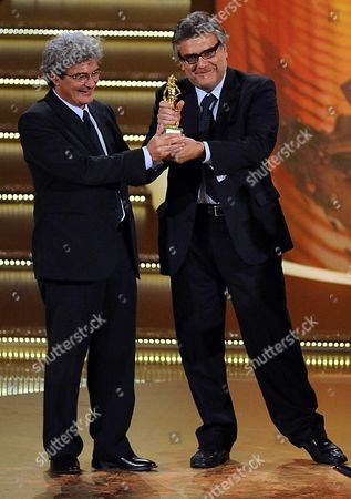 Italian Movies Director Mario Martone (l) Receives the David Award For the Best Screen Play From Itallian Screenwriter Giancarlo De Cataldo During the Celebration of the David Di Donatello Cinema Awards in Rome Italy on 06 May 2011 Italy Rome