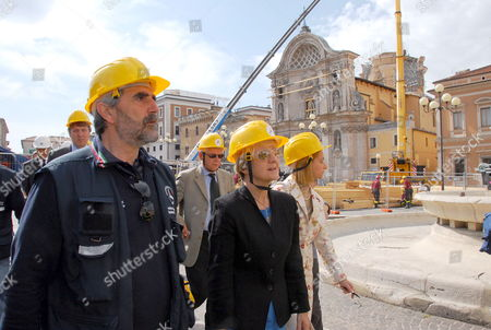 Eu Commissioner Danuta Hubner (c) and the Vice Head of Civil Protection Agostino Miozzo (l) Visit Duomo Square Partially Destroyed by the Earthquake on 06 April in L'aquila Italy on 15 May 2009 Italy L'aquila