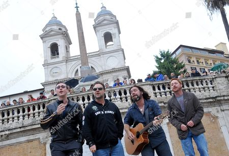 Stock Photo of Actors Kevin Durand (l-r) of Canada Russell Crowe of Australia Alan Doyle of Canada and Scott Grimes of the Us Perform on the Spanish Steps in Rome Italy 15 May 2010 the Cast Members of the Movie 'Robin Hood' by British Director Ridley Scott Held an Impromptu Performance on the Spanish Steps Italy Rome