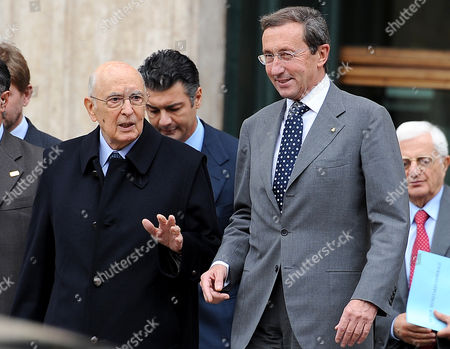 Speaker of the Italian Parliament Gianfranco Fini (r) Listens to Italian President Giorgio Napolitano (l) As They Leave the Parliament After the Presentation of a Report of 'Italia Decide' 15 November 2010 in Rome the Italian Government Faced a Fresh Crisis on 15 November As a Former Ally of Prime Minister Silvio Berlusconi Followed Through on His Threat to Withdraw His Ministers From the Government European Affairs Minister Andra Ronchi and Acting Trade Minister Adolfo Urso Along with Two Undersecretaries All Tendered Their Resignations Italy Rome