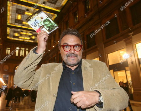 An Undated Picture Made Available on 03 January 2009 Shows Italian Photographer Oliviero Toscani with His Book 'Creativo Sovversivo' in Rome Italy According to Reports on 30 December 2008 Toscani Has Registered the Accronym Mafia - Standing 'Mediterranean Association For Internal Affair' - As a Trademark Italy Roma