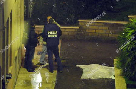 Italian Forensic Policemen Stand Next to a Sheet Covering the Body of Italian Movie Director Mario Monicelli After He Committed Suicide in a Rome's Hospital Late 29 November 2010 Mario Monicelli Born in Viareggio Tuscany on May 15 1915 was an Italian Director and Screenwriter One of the Masters of the Commedia All'italiana (comedy Italian Style) He Died at the Age of 95 After Throwing Himself From a Window of the San Giovanni Hospital in Rome where He was Admitted a Few Days Earlier For a Prostate Cancer Italy Rome